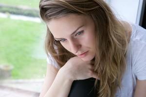 Woman sitting alone by window